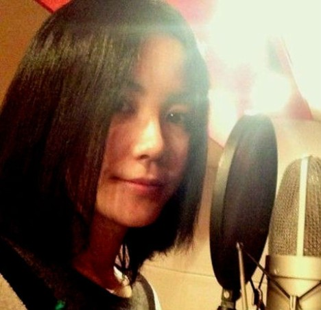 "Faye in studio recording the theme song for Vicki Zhao's film, ""So Young"" - source China Daily 4.5.13."