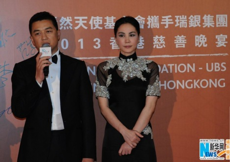 Li Yapeng and Faye Wong at the 2013 Gala Dinner of the SmileAngel Foundation in  Hong Kong, South China, May 27, 2013.